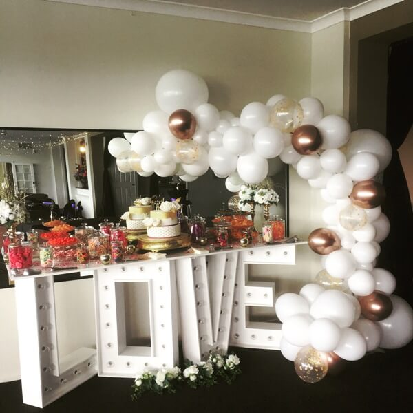 Organic Arch with extended bottom twisting around your candy dessert bar for an amazing effect. Balloon Garland Bundaberg