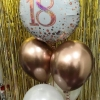 Table Centrepiece Balloon Bouquet featuring a Foil balloon and four latex Balloons